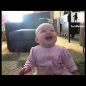 Baby girl laughs uncontrollably